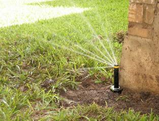 pop up sprinkler head fails to provide proper irrigation coverage to yard